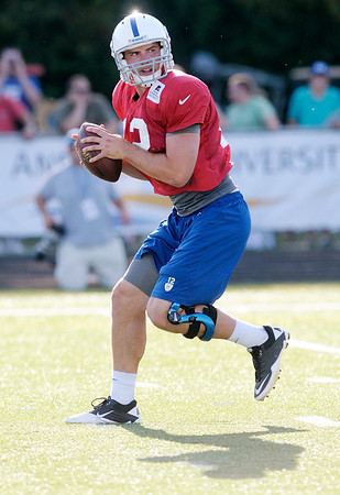 Andrew Luck runs through a passing drill during the first evening practice at Colts camp on Tuesday.