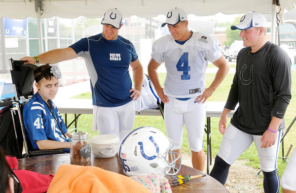 Don Knight/The Herald Bulletin<br /> From right, Pat McAfee Adam Vinatieri and Mat Overton talk with Mia Benge after practice at Colts Camp on Thursday.