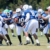 Cory Redding (90) in the middle of a linemen drill during Colts camp on Thursday.