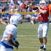 Andrew Luck gets set to throw to a receiver at Colts camp on Thursday.