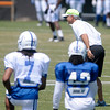 Head coach Chuck Pagano dons a neon helmet cover and lines up with the defense on special teams during a light moment during Colts Camp at Anderson University on Thursday.