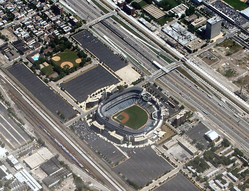 """US Cellular Field (New Comiskey Park) from the air as we landed in Chicago..  Old Comiskey was where the parking lot off the third base side (across 35th Street) is now.  The small circle visible at lower left-center of that parking lot is the old home plate.  The diamonds in the park to the upper left of the """"Old Comiskey"""" parking lot have been there since the 1950s at least."""