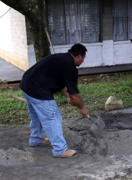 Chico showing us how it is done.  Mixing concrete by hand is hard labor.