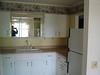 kitchen, (unseen washing machine/dryer, stove, oven)