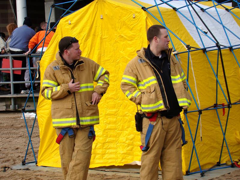 Firemen changing tent