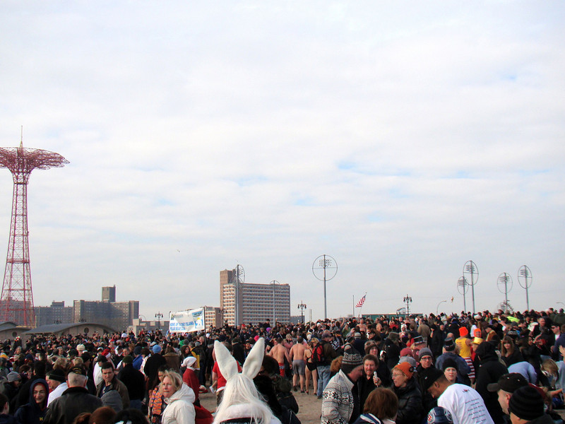 the mob scene descends the beach