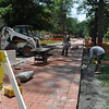 Quad Conversion.  Brick being laid in front of student center.  13-June 2012.