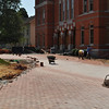 Workmen put final touches on the brick pathway in front of Seney.