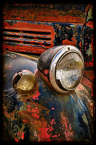 Old truck detail at the antique car junkyard in Springfiled, Oregon  Photographer's Name: Alex Morley Photographer's City and State: Creswell, OR  To vote in favor for this photo, simply add a comment below. You can also share this photo on Facebook and Twitter using the buttons above.