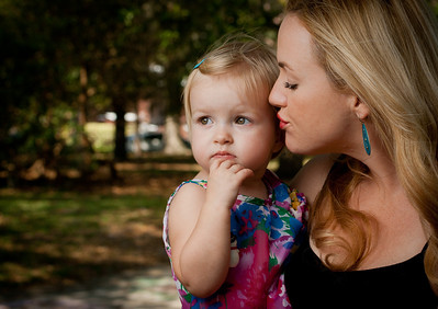 Grabbing strangers . Portrait of mum n child .  Photographer's Name: Jason Wilkie Photographer's City and State: Jacksonville, FL  To vote in favor for this photo, simply add a comment below. You can also share this photo on Facebook and Twitter using the buttons above.