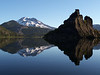 South Sister, with lava protruding from the glassy surface of Sparks Lake