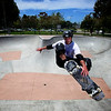 Jeremy Chase performs an Indy at the Costa Mesa Skate park.