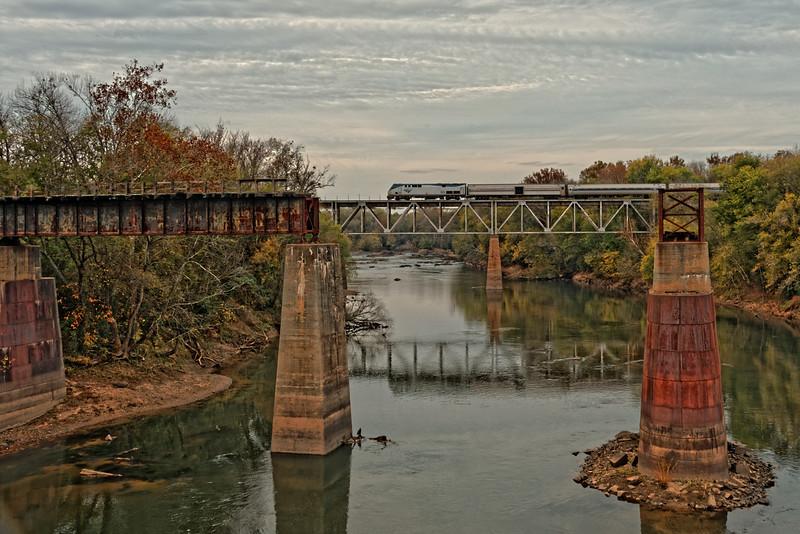 New Railroad Bridge over Roanoke River, Weldon, NC.  Old Wilmington and Weldon Raiload Trestle, 1840, in foreground.