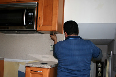 Taking down the backsplash in preperation to replace the counter top.