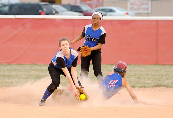 Elwood's Taylor Noone beats the throw to APA's Bethany Sulc as she steals second base during the first round of the County Softball Tournament at Frankton.