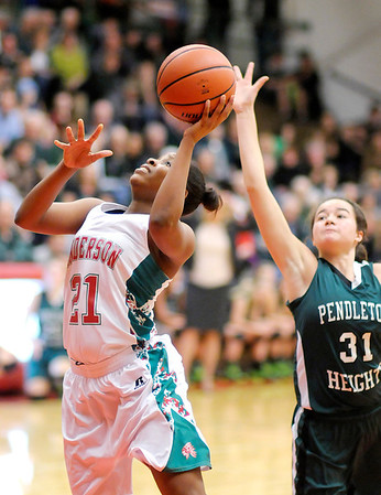 Don Knight / The Herald Bulletin<br /> Anderson's Da'Sha Boyd shoots as the Indians faced the Pendleton Heights Arabians in the first round of the Madison County Basketball Tournament on Friday.