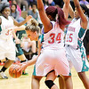 Don Knight / The Herald Bulletin<br /> Pendleton Heights' Kelsee Wendling is double teamed by Anderson's Kez'Anique Gosha (34) and Ania Daniels (25) during the first round of the Madison County Basketball Tournament on Friday.