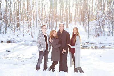 Family in winter snow