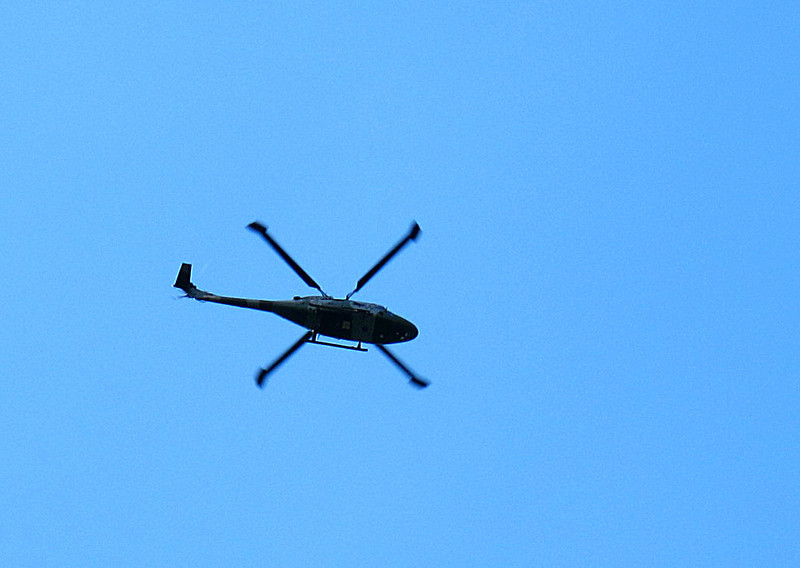 An army helicopter clatters about for about half an hour