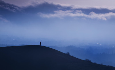 Lone figure on hill
