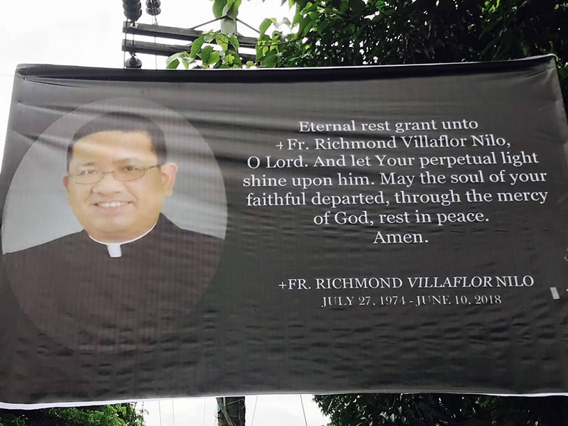 NUEVA ECIJA. A tarpaulin streamer bearing the image of slain Catholic priest Fr. Richmond Nilo is displayed during his funeral on Friday, June 15, 2018 in Cabanatuan, Nueva Ecija. (Photo contributed by Central Luzon police)