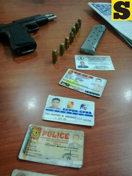 Identification cards of former Police Officer 3 Geoffrey Borinaga and his licensed gun were among the evidences gathered on Thursday following his arrest several hours after victim Armando Daligdig was shot. (Photo by Armie Garde of Sunnex)