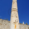 tall roman column with capital and shell holes from attacks in the old forum of Zadar,  Croatia