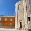 ancient UNESCO listed  byzantine basilica next to a rennaissance building at Zadar in Croatia