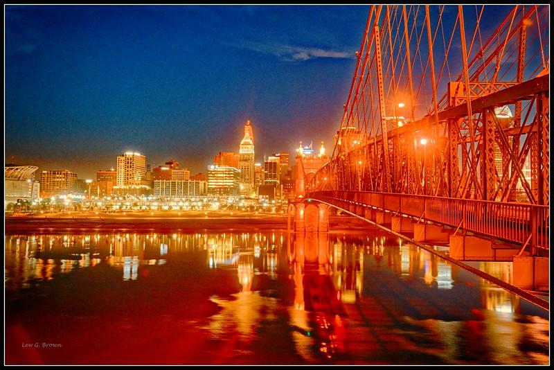 Sunrise in Cincinnati, view 1.  Roebling Bridge, 1866, over Ohio River.