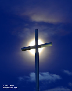 A photo I made of the cross at my church before sunrise with the moon on Memorial Day 2013.