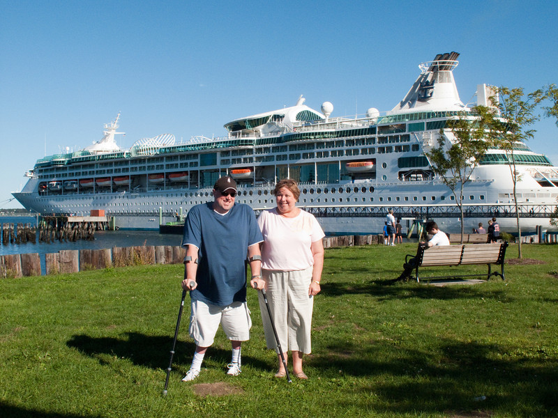 Martha an Dave with Enchantment of the Seas in the background