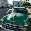Classic chevy in front of the Palacio Ferrer on the Parque Jose Marti in Cienfuegos