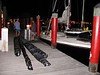 Plastic-wrapped hang gliders, propane cylinders for the balloon and other equipment are ready to load on the sailboat in Key West.
