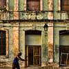 Man pushing cart, Havana