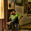 Artist on the porch of his studio, Havana. This is the artist son of the mother I wrote about earlier. He was unintelligible, even to Margaret who speaks fluent Spanish. I bought a couple of his paintings for 5$.
