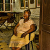 Woman in her home, Havana. I met this woman about a half hour after we arrived in Havana. We were waiting to get into the bank next door to change money. Her son is an artist and their home does double duty as his studio.