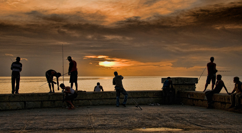 Fishing at Sunset on the Malecon,<br /> Havana. I have read many places that an odd number of people in photographs is more pleasing than an even number.