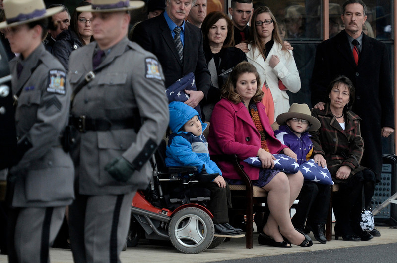 Mike McMahon - The Record,  Amy, and their sons, Caleb, 6, and Zachary, 4, Cunniff ,  father at right Kenneth D. and mother Deborah Lanphear Cunniff at funeral services for Trooper David Cunniff at the Grace Fellowship church in Latham,  December 18, 2013.