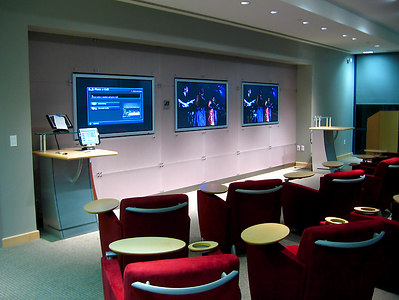 "This demo room utilizes three flush mounted 61"" plasmas to show a variety of video sources."