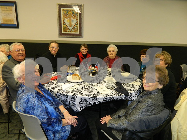 Left to right: Louise Vogel, Fr. Dennis Sevcik, Kurt Wilke, Sandy Wilkke, Marigene Lennon, Dorothy Thoma, Karen Heun, Betty Hallberg