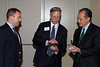 Jim Knopf '89 and James von Rittmann '95 proudly demonstrate the iDAASV app to President Jim Yong Kim '82a.