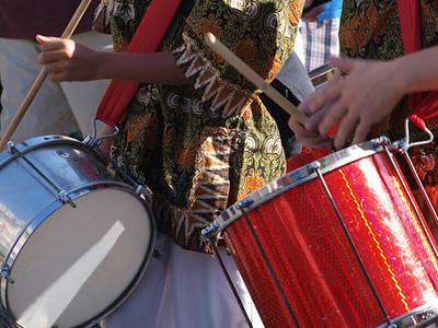 Brazil samba carnival musicians play on drums
