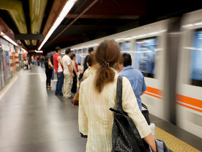 Passengrs get ready to ride the subway in Rome, Italy/