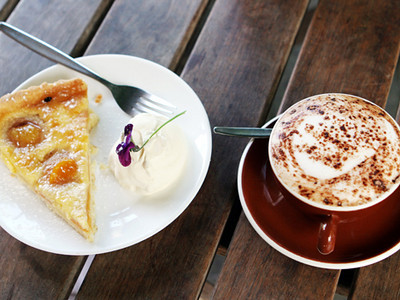 Apricot pie and cream with a cafe latte.
