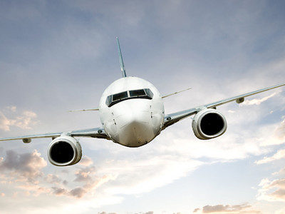 Airplane in Flight at Sundown