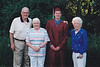 Jim and Joan with Greg and Grandma Alice on his high school graduation. (June, 2002)