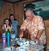 george cutting cake