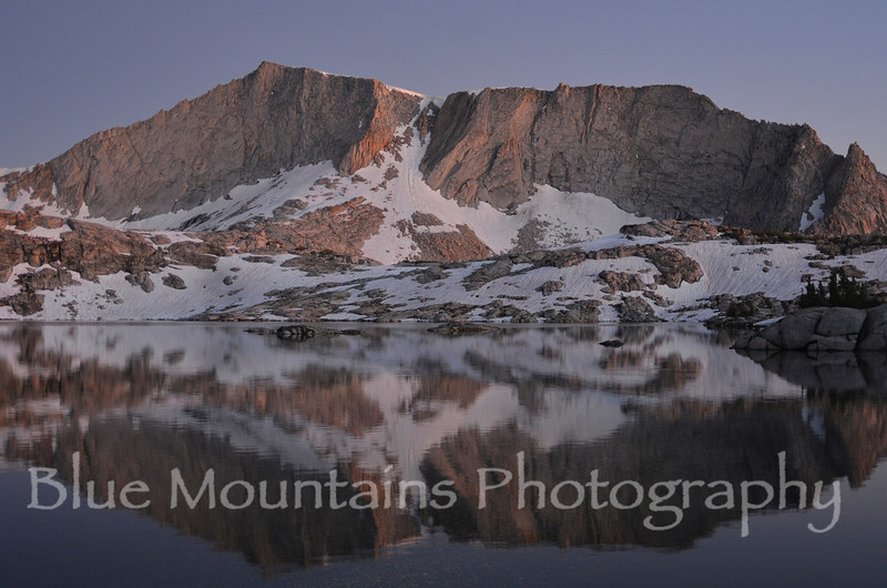 "Thank you for your kind comments yesterday on my poppy photo.  Thought I would change the theme from flowers to mountains in anticipation of the summer hiking season.  This is a shot of ""Hell for Sure"" Lake in the Sierra Nevada Range taken last summer."