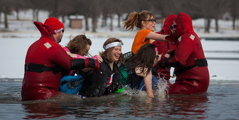 16FEB2013<br /> <br /> Polar Plunge<br /> <br /> Omaha had its form of the Polar Plunge today out at Lake Cunningham....<br /> <br /> A big fundraiser for the Special Olympics. These gals are trying to take out the rescue squad boys that are there to help.<br /> <br /> It was twenty-five degrees with two fresh inches of snow, moving in and out of overcast skies.<br /> <br /> Make it a great weekend!