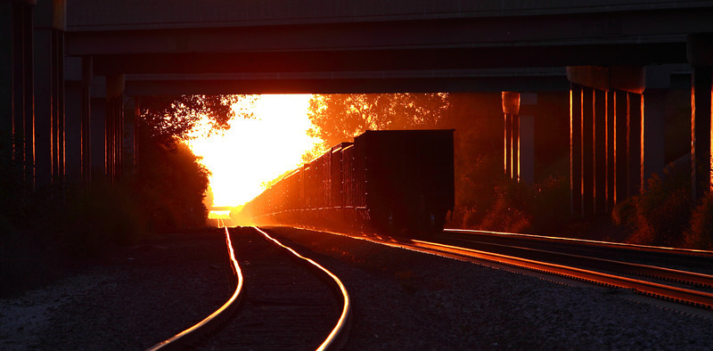 Went down to the train tracks last night at sunset. Moving money, Union Pacific coal train on the return trip empty back to Wyoming. The sunset is now aligned with the tracks when on the horizon, it happens for only a week and its been bright, no clouds at sunset......thanks for the great comments!